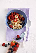 Whole grain rice with apple syrup and fresh berries
