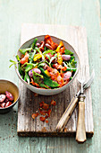 Colourful bean salad with grilled peppers and bacon