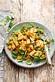 Grilled hazelnut polenta with a sweet potato and purslane salad