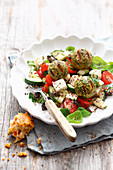 Grilled chickpea balls with a country salad