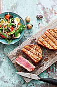 Grilled tuna fish steaks with salad nicoise