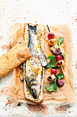 Grilled stuffed bass in pastry, and grilled vegetables skewers