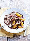 Veal steak with radicchio and orange salad