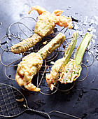 Stuffed, battered courgette flowers