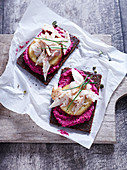 Beetroot cream with smoked trout on pumpernickel bread
