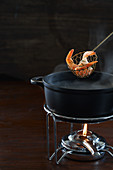 Fish fondue with prawns