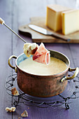 French fondue with bread and ham
