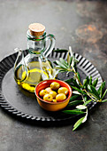 Olives, olive oil and an olive sprig