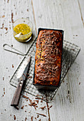 Banana and chocolate loaf cake with passion fruit sauce