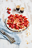 Chocolate and strawberry cheesecake with flaked almonds