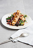 Fish with an almond crust and chard vegetables