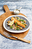 Salmon with cauliflower couscous and sesame seed sauce