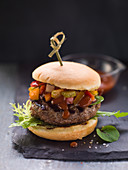 A classic beef burger with BBQ sauce and salad