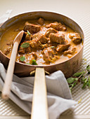 Veal and cream goulash with potato cubes