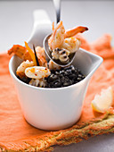 Black risotto with shrimps and squid
