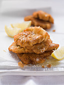 Small sausage schnitzels with lemon