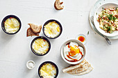 Oven-baked eggs with bacon, scrambled eggs with shrimps, and eggs on creamy quark