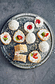 Sweet rice pudding sushi with bright berries and kiwi