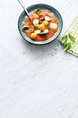 Cold tomato soup with melon and mozzarella balls