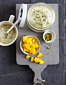 Millet porridge with chia seeds, mango and pistachios