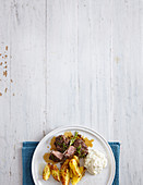 Roasted lamb with a linseed crust, baked potatoes and cauliflower purée
