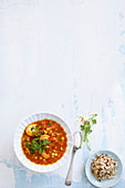Pea and tomato curry with shrimps