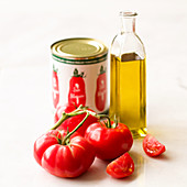 Simple tomato and olive oil still lfie on a white background