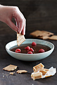 Toffee fondue with raspberries and butter biscuits