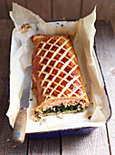 Spinach and salmon strudel, sliced