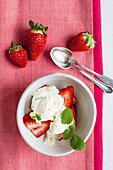 Lime and honey ice cream with strawberries