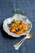 Prawns with carrot tagliatelle and peas