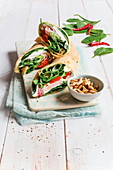 Turkey and spinach wraps with ricotta and pine nuts
