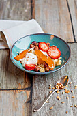 Quinoa muesli with fresh fruit and yoghurt