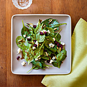 Spinach salad with gorgonzola, pine nuts and pomegranate seeds