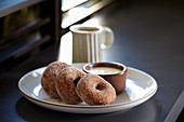 Buckwheat doughnuts with creme anglaise and coffee