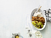 Turkey gyros with rice and a grape and Chinese cabbage salad