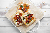 Savory pastry with goat cheese, half dried tomatoes, spinach and pine nuts