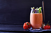 A tomato and celery smoothie with chili and basil