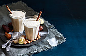 Almond and chai smoothies with dates and lucum powder