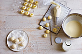 Filled, white chocolate truffles being made