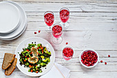 Lentil salad with gratinated goat's cheese and sparkling pomegranate wine