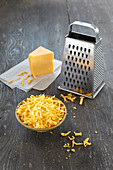 Grated Cheddar cheese for fondue