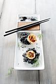 Scallops on sepia rice (Asia)