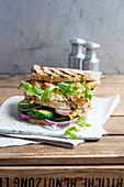 A club sandwich with chicken breast and grilled vegetables