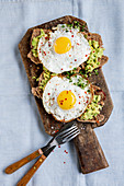 Walnut and spelt bread with avocado mousse and fried eggs