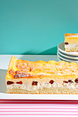 Eierschecke (tray bake yeast dough cake topped with apple, quark and poppyseeds from Saxony – trend from the 1950s)
