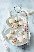 Gingerbread macaroons on a cake stand