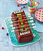 A table football cake with gummy bears