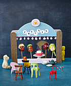 A puppet theatre with chocolate marshmallow faces