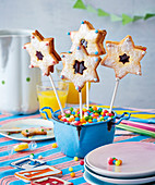 Magic wand lollies made from biscuit stars